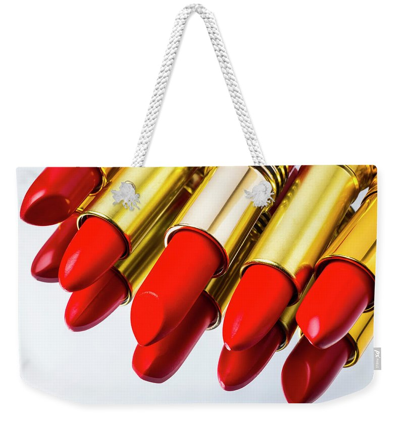 Cosmetics Weekender Tote Bag featuring the photograph Reflection Of Red Lipstick by Garry Gay