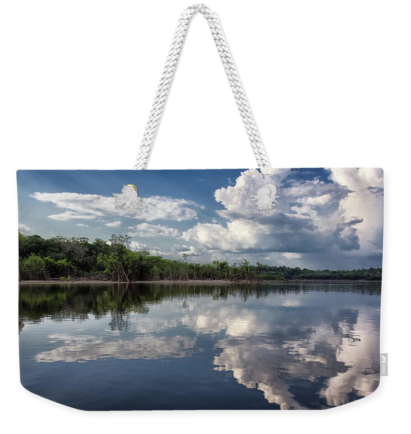 Scenics Weekender Tote Bag featuring the photograph Reflections In Amazon River by By Kim Schandorff