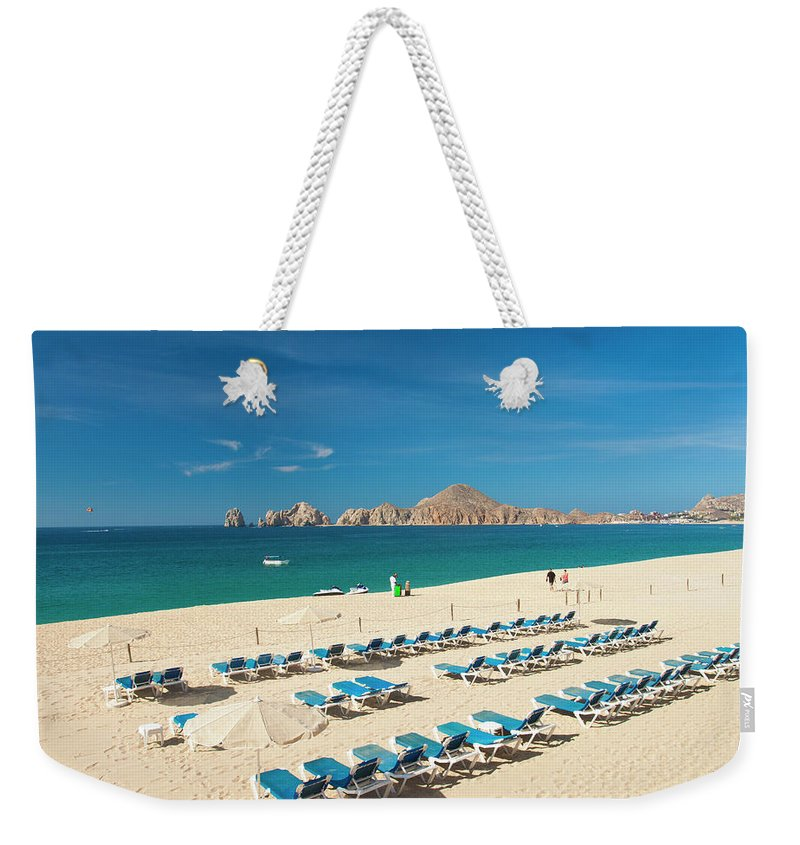 Water's Edge Weekender Tote Bag featuring the photograph Resort Beach Chairs by Christopher Kimmel