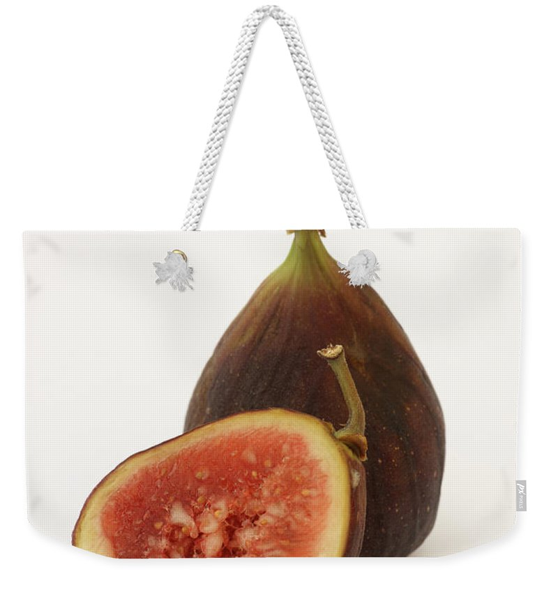 White Background Weekender Tote Bag featuring the photograph Ripe, Fresh Figs On White Background by Rosemary Calvert