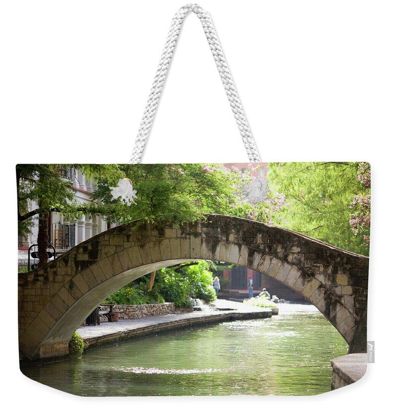 Water's Edge Weekender Tote Bag featuring the photograph Riverwalk Stone Arch Bridge by Samdiesel