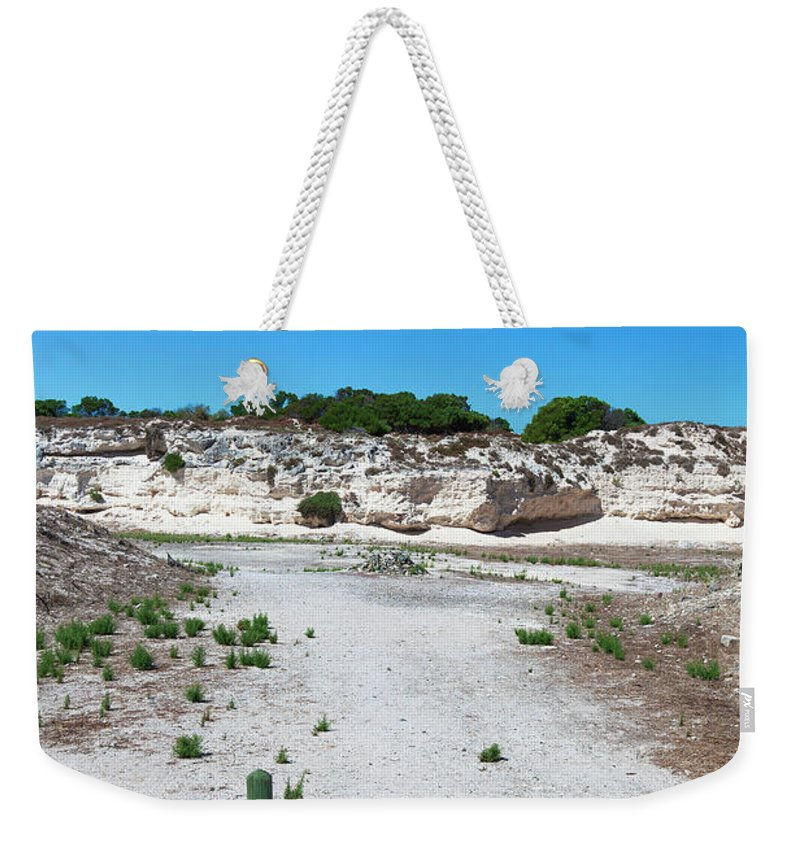 Tranquility Weekender Tote Bag featuring the photograph Robben Island Quarry Stone Pile by Iselin Valvik Photography