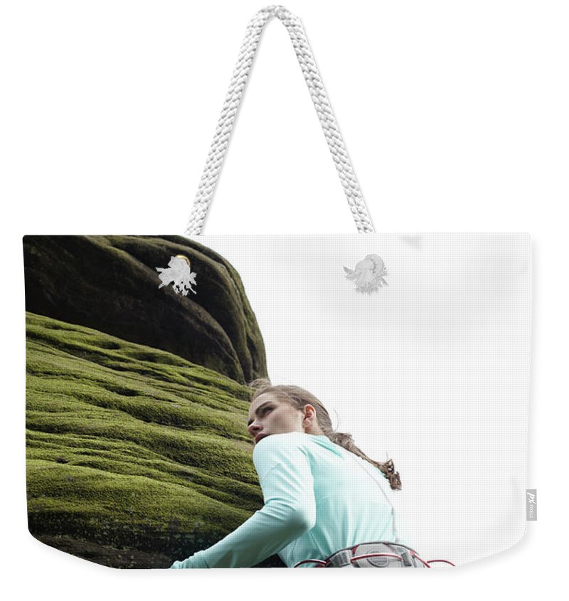 Human Arm Weekender Tote Bag featuring the photograph Rock Climber Scaling Boulder by Tim Hall