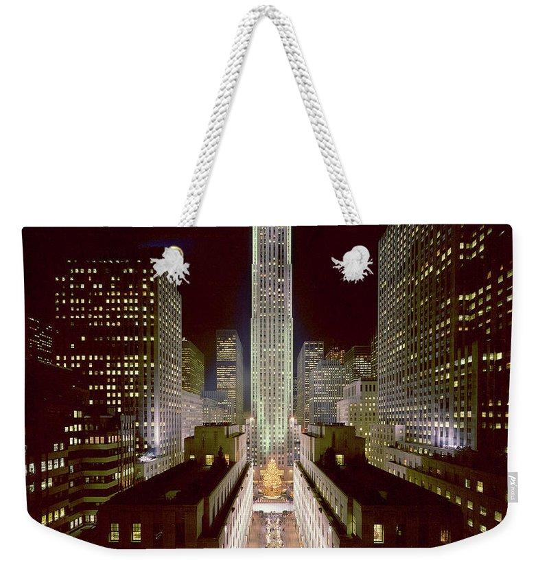 1980-1989 Weekender Tote Bag featuring the photograph Rockefeller Center, Manhatten, At by Thorney Lieberman