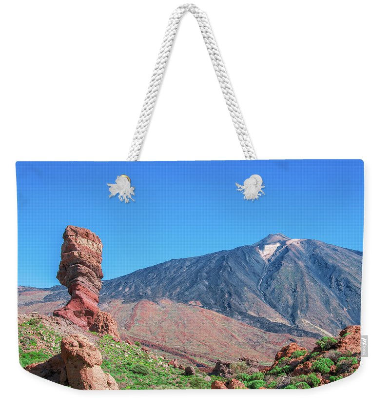 Mountains Weekender Tote Bag featuring the photograph Roque Cinchado In Front Of Mount Teide by Sun Travels