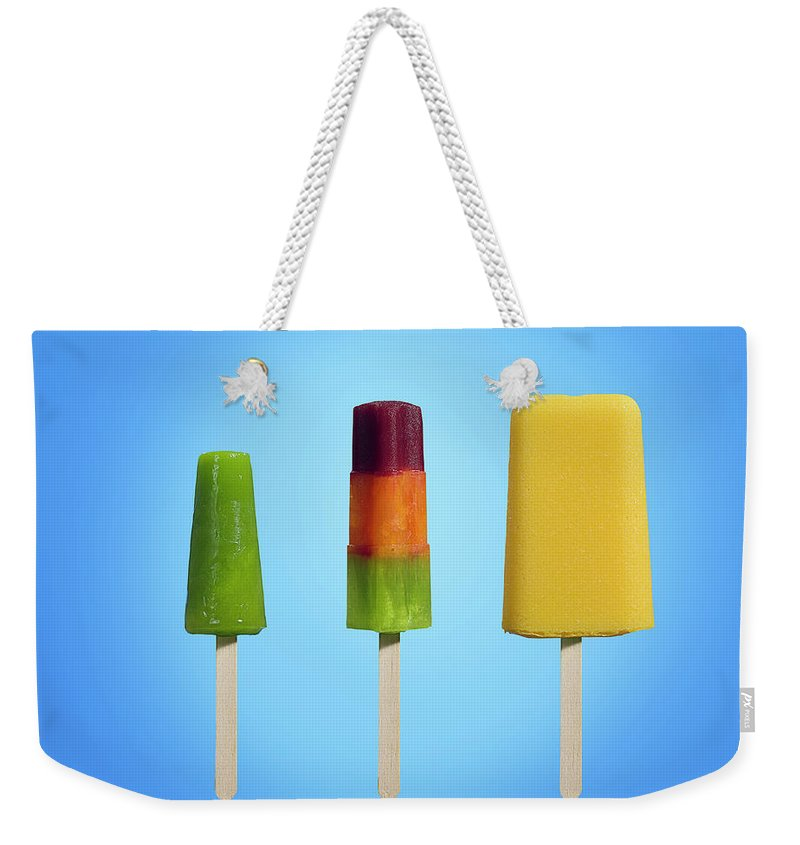 In A Row Weekender Tote Bag featuring the photograph Row Of Different Types Of Ice Cream by Jonathan Knowles