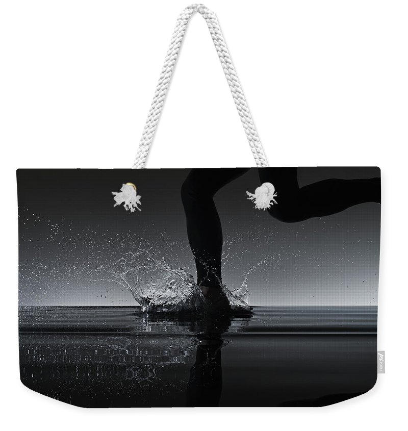 Recreational Pursuit Weekender Tote Bag featuring the photograph Running Through Water by Jonathan Knowles