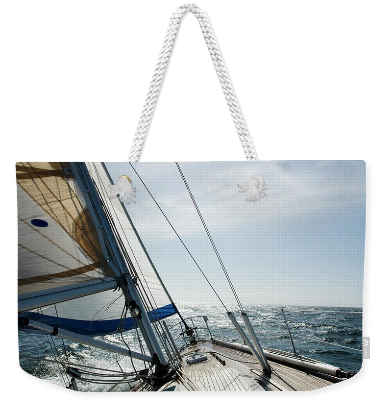 Wind Weekender Tote Bag featuring the photograph Sailing by Juhokuva