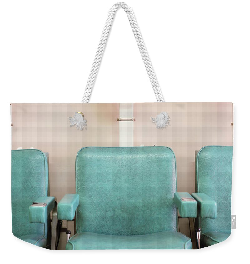 In A Row Weekender Tote Bag featuring the photograph Salon Hair Dryers by Lisa Romerein