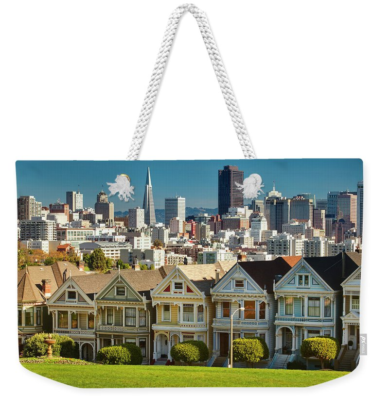 San Francisco Weekender Tote Bag featuring the photograph San Francisco Postcard Row Skyline by Pgiam