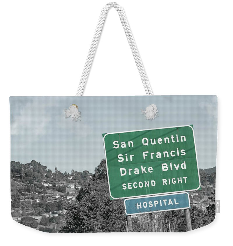 San Weekender Tote Bag featuring the photograph San Quentin California Highway Sign by Betsy Knapp