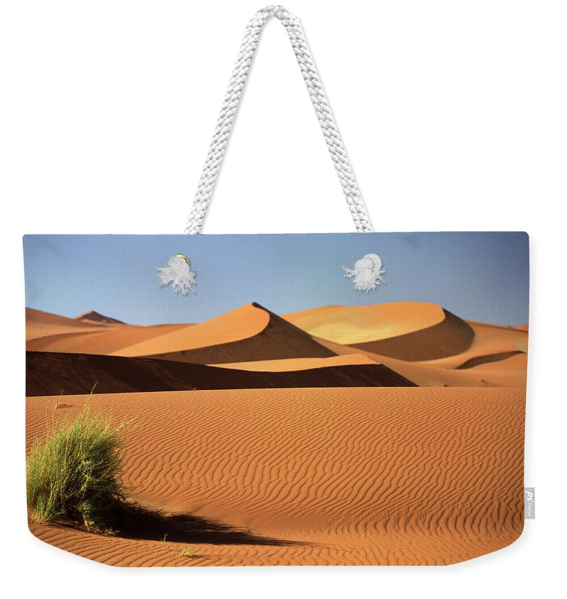 Shadow Weekender Tote Bag featuring the photograph Sand Dunes In Namib Desert, Namibia by Walter Bibikow