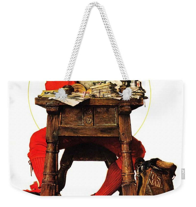 Christmas Weekender Tote Bag featuring the drawing Santa At His Desk by Norman Rockwell