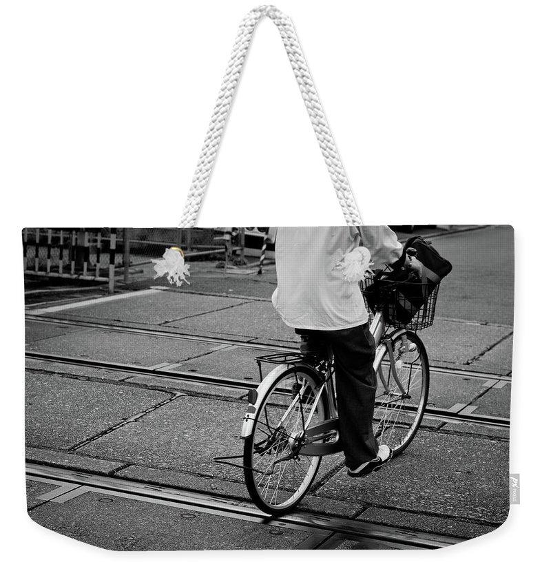 Child Weekender Tote Bag featuring the photograph Schoolboy Bicycling Across Railroad by Hedgy Nathan Wright