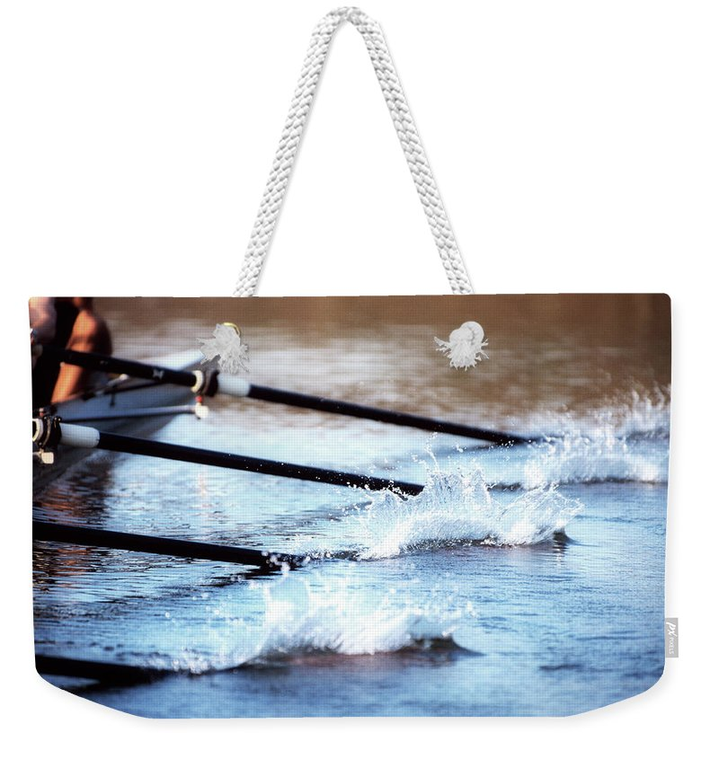 Sport Rowing Weekender Tote Bag featuring the photograph Sculling Team Rowing On Water by Robert Llewellyn