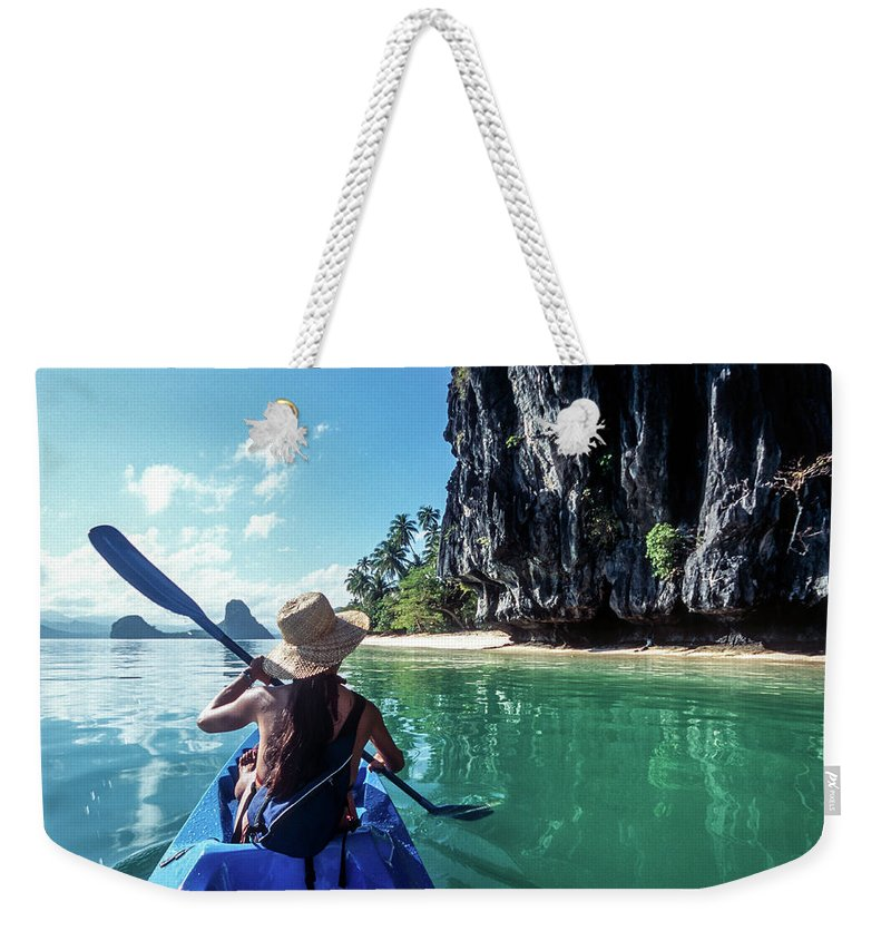 Southeast Asia Weekender Tote Bag featuring the photograph Sea Kayaking by John Seaton Callahan