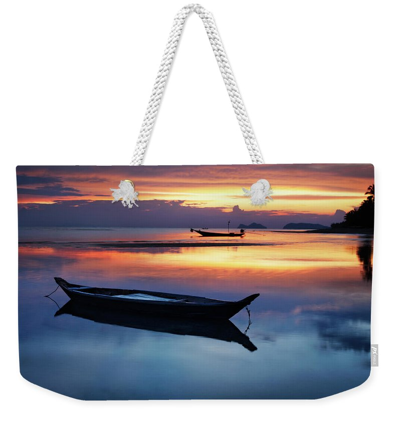 Scenics Weekender Tote Bag featuring the photograph Seashore With Longtail Boats At Sunset by Henrik Sorensen
