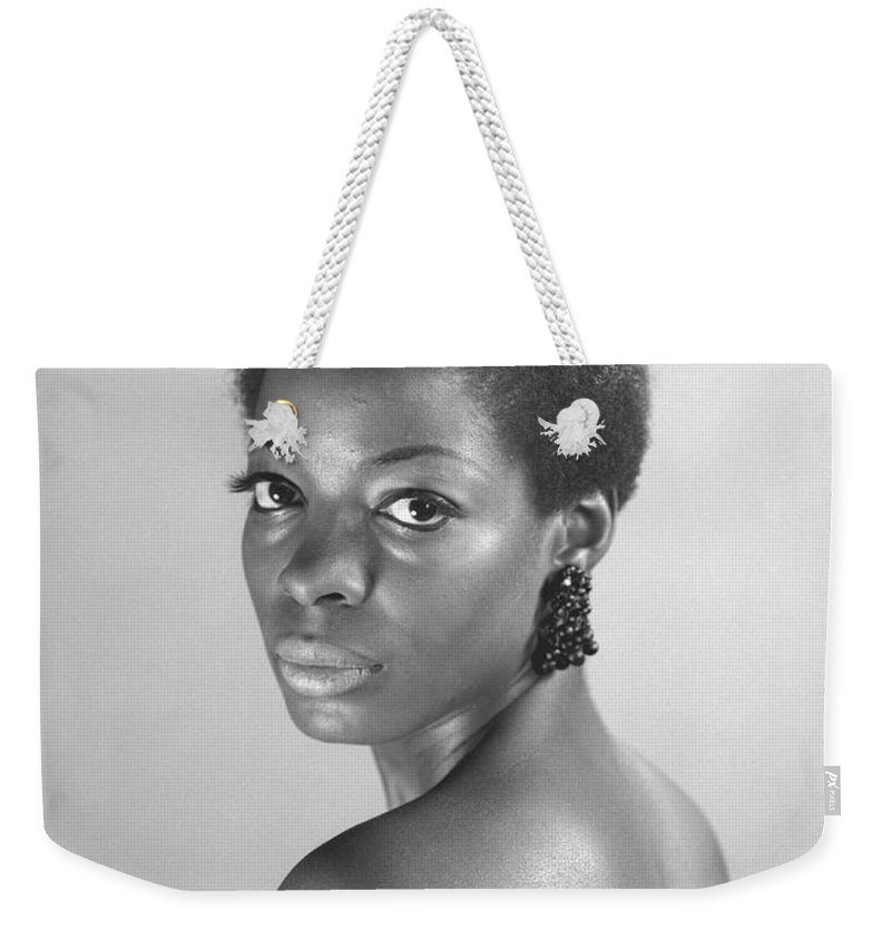 Looking Over Shoulder Weekender Tote Bag featuring the photograph Semi Dress Woman Posing In Studio, B&w by George Marks