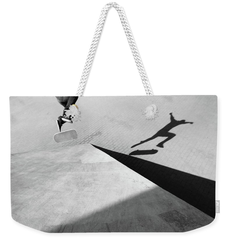 Shadow Weekender Tote Bag featuring the photograph Shadow Of Skateboarder by Mgs