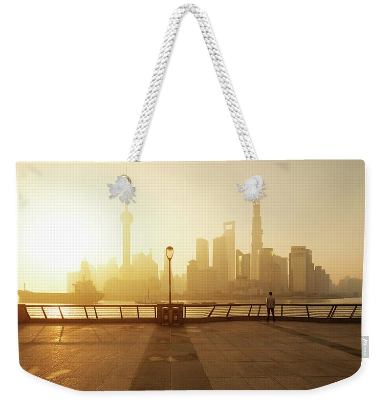 Tranquility Weekender Tote Bag featuring the photograph Shanghai Sunrise At Bund With Skyline by Spreephoto.de