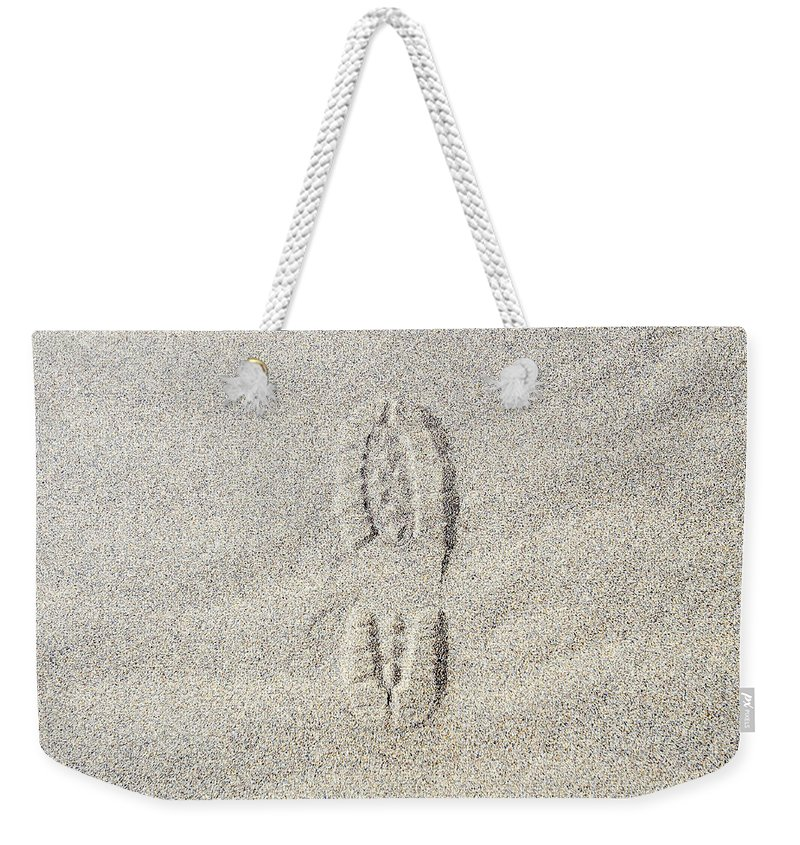 California Weekender Tote Bag featuring the photograph Shoe Print In Sand by Thomas Northcut