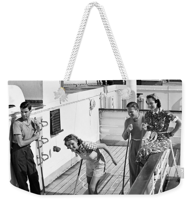 Heterosexual Couple Weekender Tote Bag featuring the photograph Shuffleboard Players by George Marks