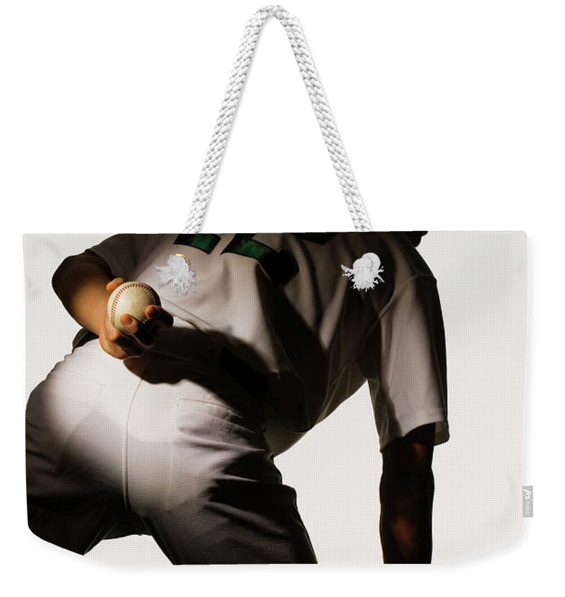 Three Quarter Length Weekender Tote Bag featuring the photograph Silhouette Of Baseball Pitcher Holding by Pm Images