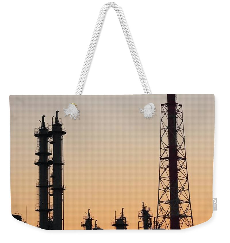 Built Structure Weekender Tote Bag featuring the photograph Silhouette Of Petrochemical Plant by Hiro/amanaimagesrf
