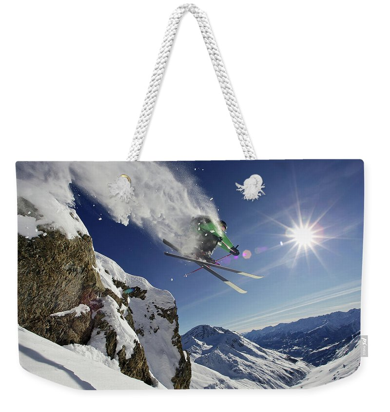 Young Men Weekender Tote Bag featuring the photograph Skier In Midair On Snowy Mountain by Michael Truelove