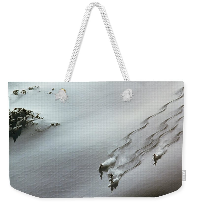 Shadow Weekender Tote Bag featuring the photograph Skier Moving Down In Snow On Slope by John P Kelly