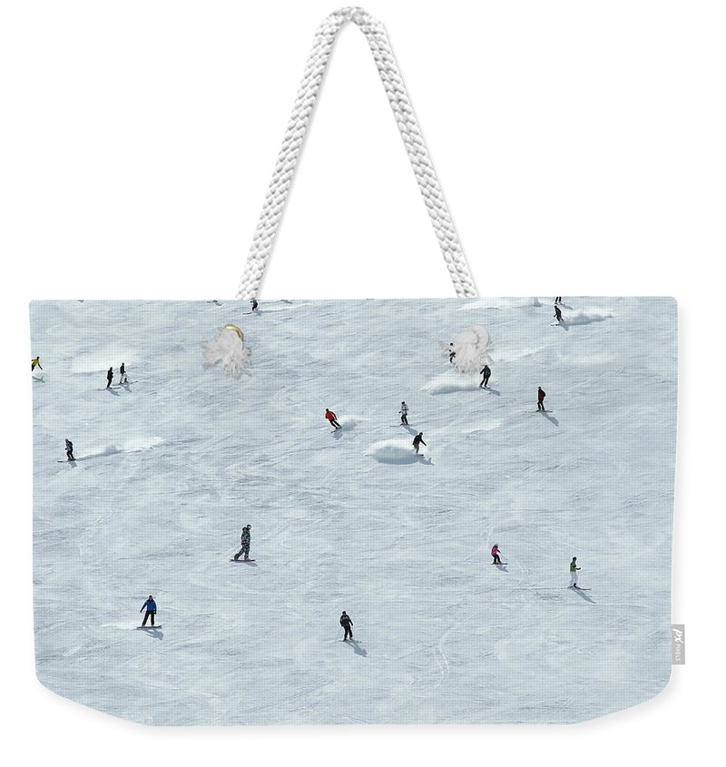 Skiing Weekender Tote Bag featuring the photograph Skiing In Mayrhofen Austria by Mike Harrington