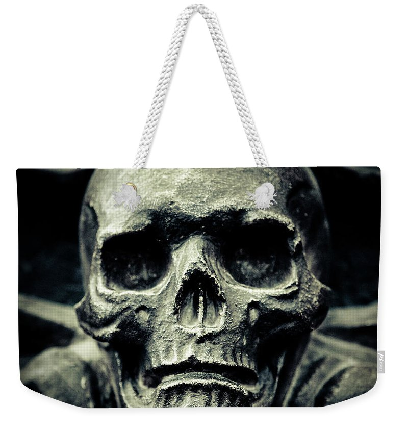 Gothic Style Weekender Tote Bag featuring the photograph Skull by Thepalmer