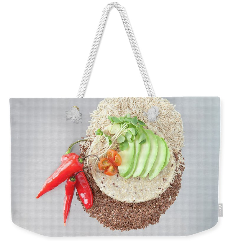Flax Seed Weekender Tote Bag featuring the photograph Sliced Avocado And Peppers With Grains by Laurie Castelli