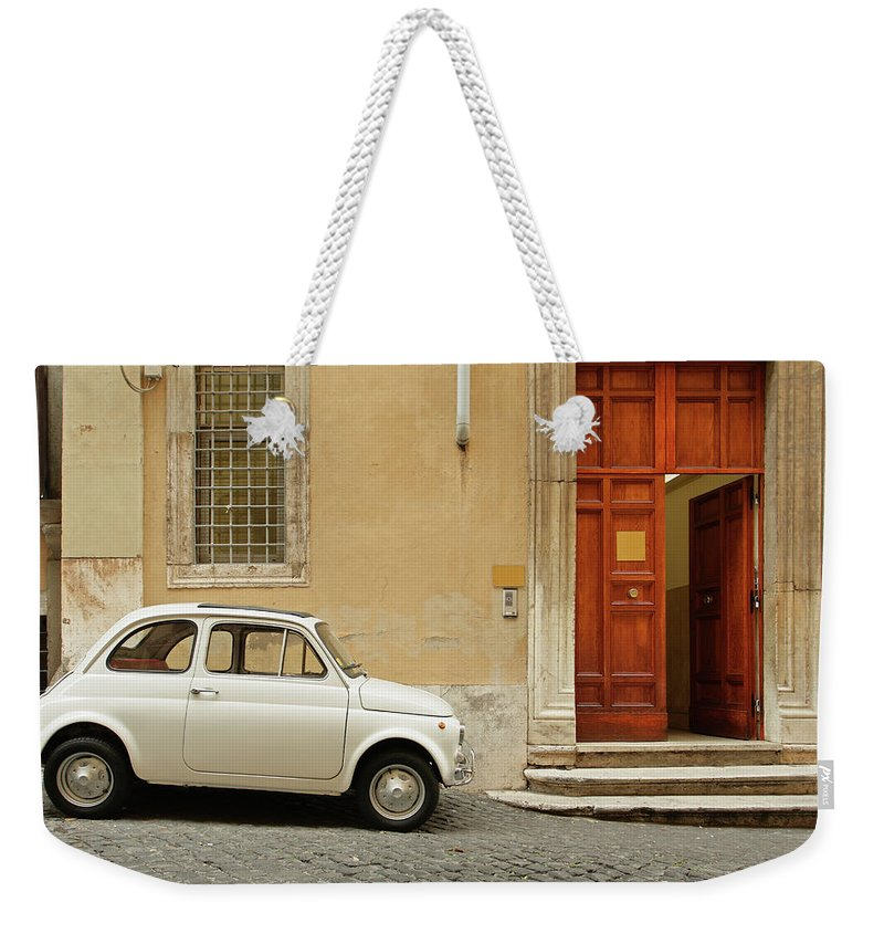 Steps Weekender Tote Bag featuring the photograph Small Coupe Parked Near A Doorway On A by S. Greg Panosian
