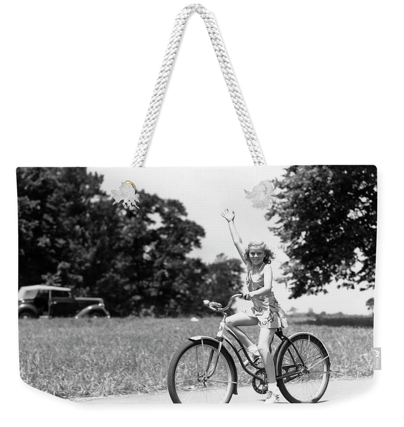 Bicycle Seat Weekender Tote Bag featuring the photograph Smiling Girl Wearing A Jumper Short Set by H. Armstrong Roberts