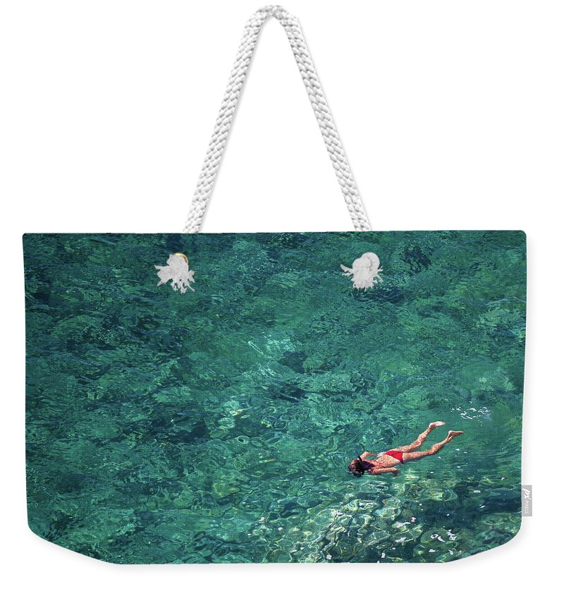 Recreational Pursuit Weekender Tote Bag featuring the photograph Snorkeling In The Mediterranean Sea by Photovideostock