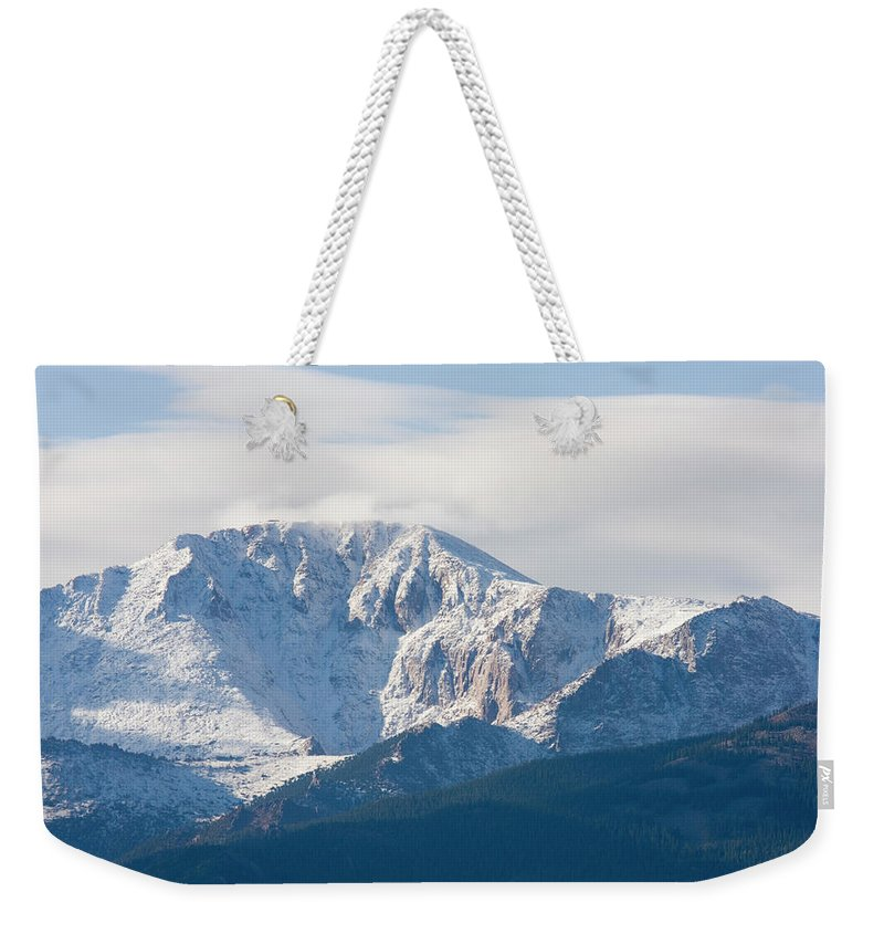 Extreme Terrain Weekender Tote Bag featuring the photograph Snowy Pikes Peak by Swkrullimaging