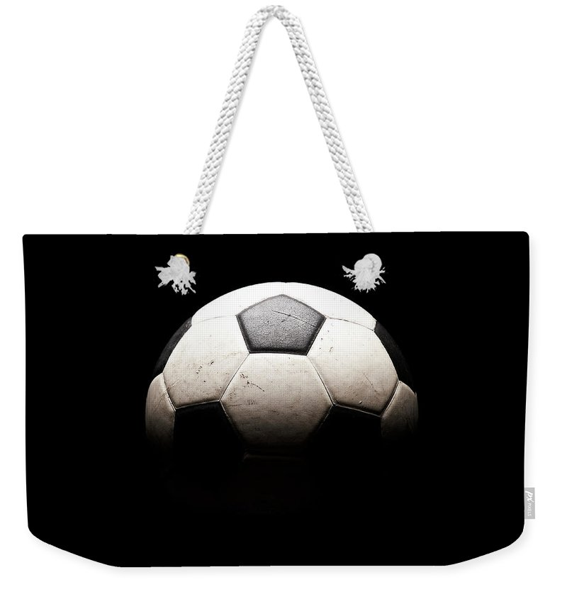 Shadow Weekender Tote Bag featuring the photograph Soccer Ball In Shadows by Thomas Northcut