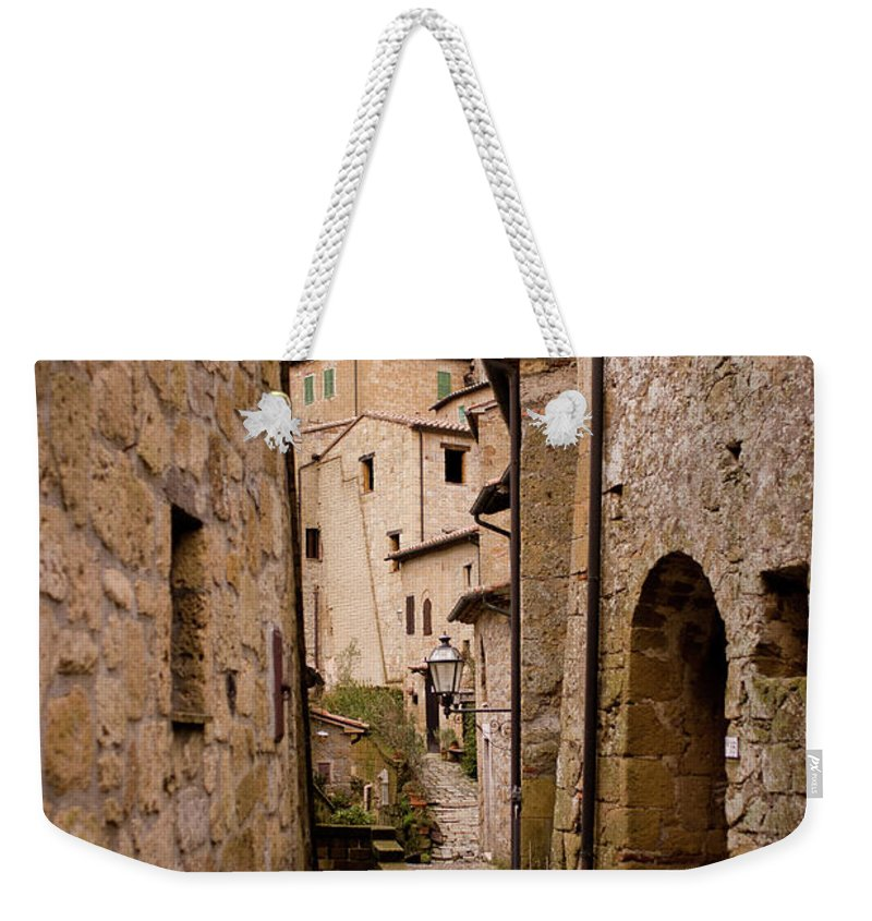 Tranquility Weekender Tote Bag featuring the photograph Sorano, Clock Tower by Luca Deravignone