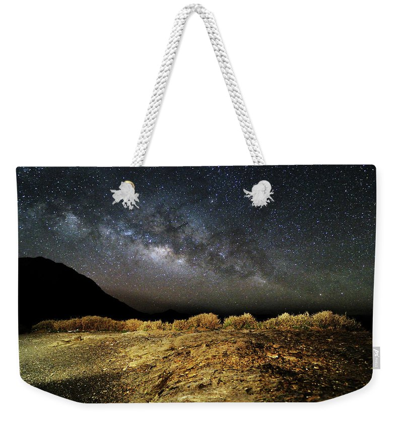 Scenics Weekender Tote Bag featuring the photograph Space by Copyright Of Eason Lin Ladaga