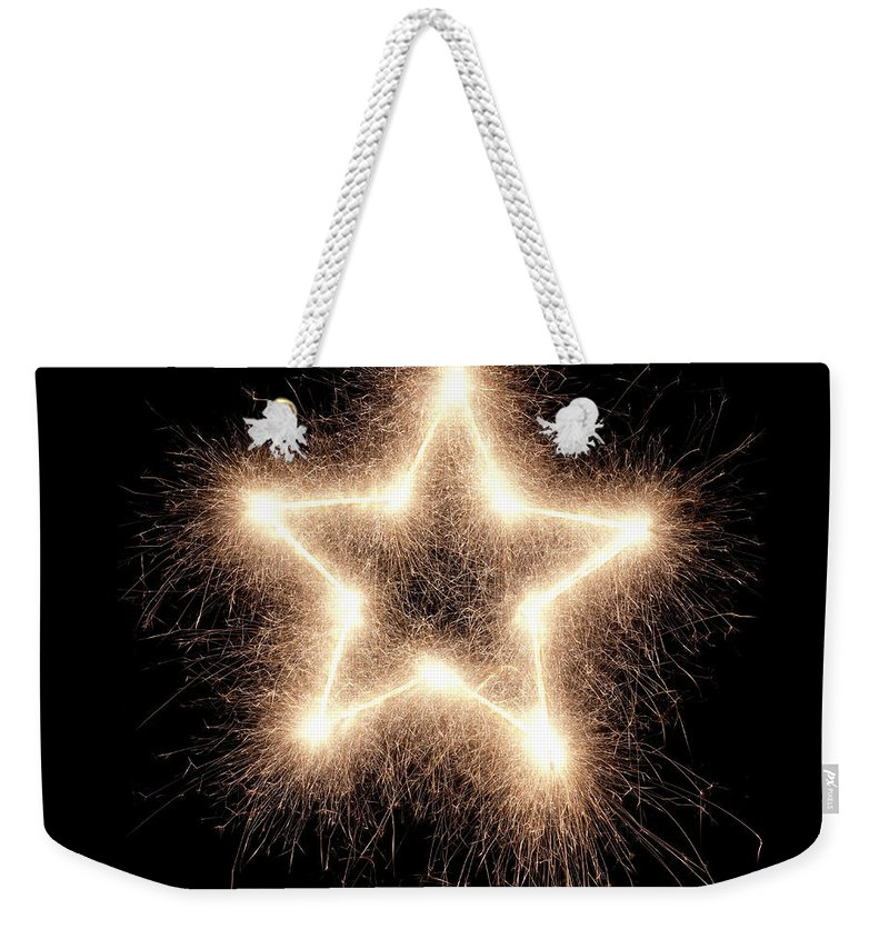 Holiday Weekender Tote Bag featuring the photograph Sparkling Star by Amriphoto