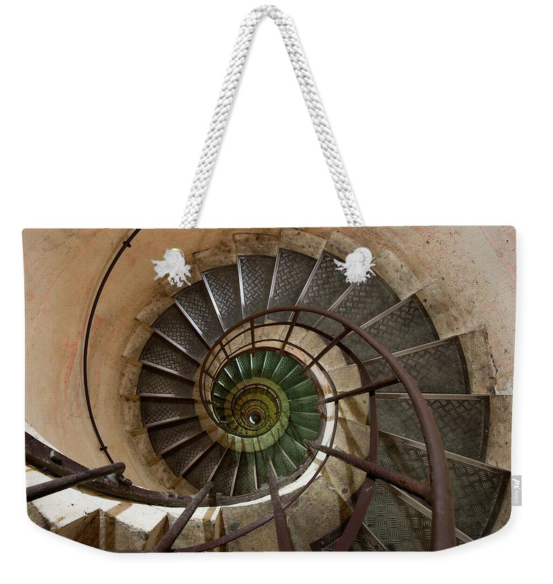 Built Structure Weekender Tote Bag featuring the photograph Spiral Staircase In The Arc De by Mint Images/ Art Wolfe
