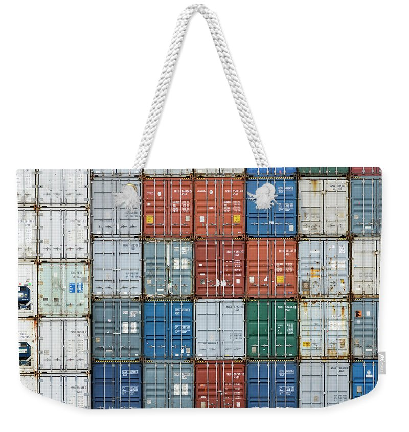 Trading Weekender Tote Bag featuring the photograph Stack Of Cargo Containers Full Frame by Andy Andrews