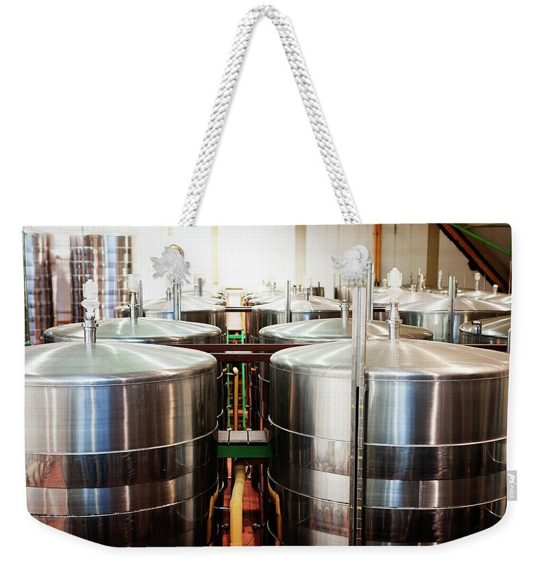 Working Weekender Tote Bag featuring the photograph Stainless Steel Holding Tanks In A by Rapideye