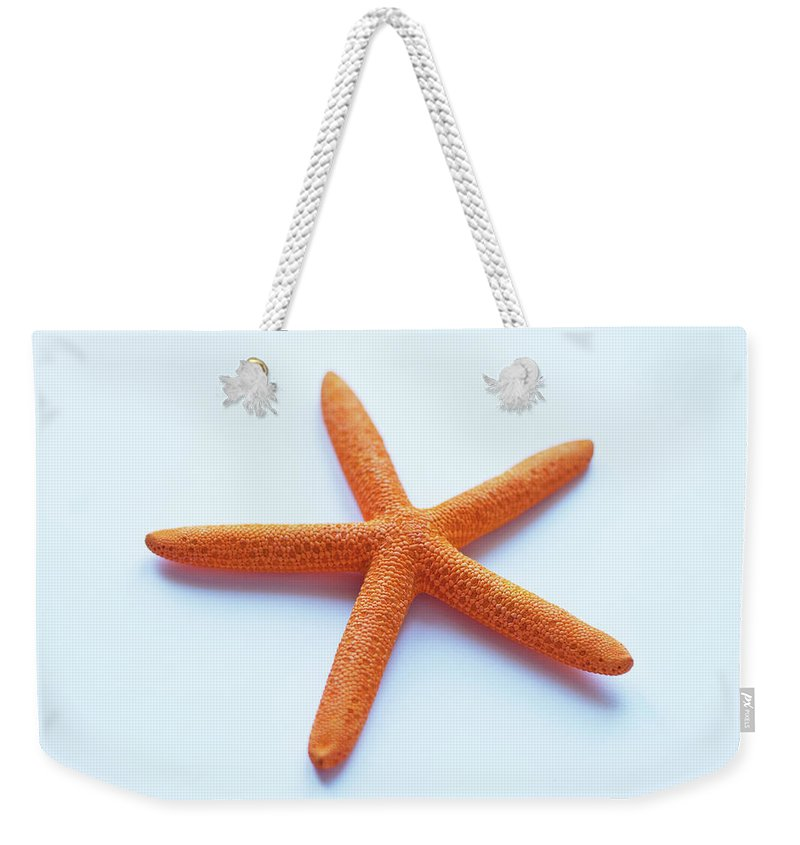 Orange Color Weekender Tote Bag featuring the photograph Starfish by Copyright Mcbargados