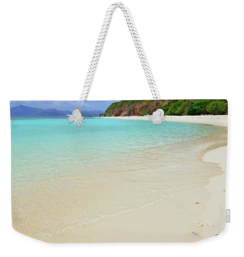 Water's Edge Weekender Tote Bag featuring the photograph Starfish On Beach Sand by Joyoyo Chen