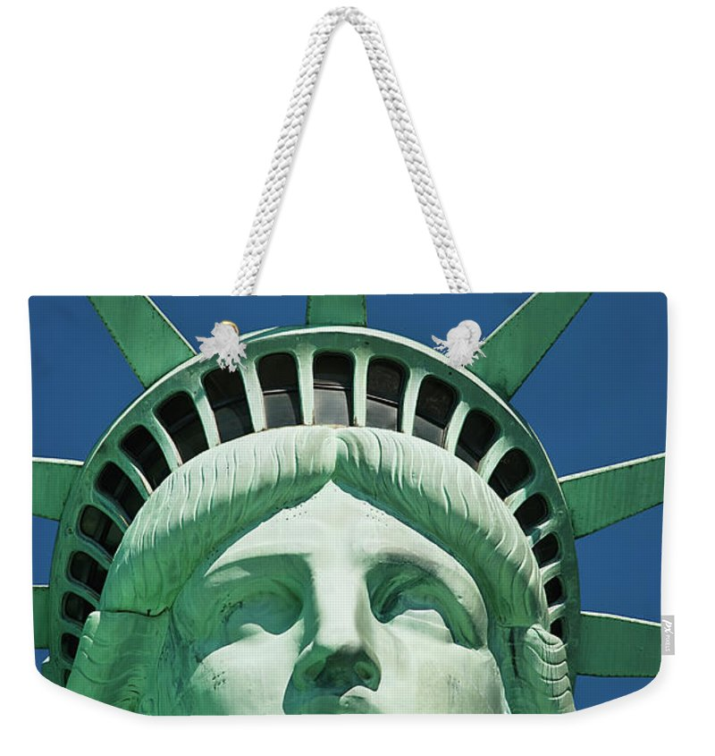 Crown Weekender Tote Bag featuring the photograph Statue Of Liberty by Tetra Images