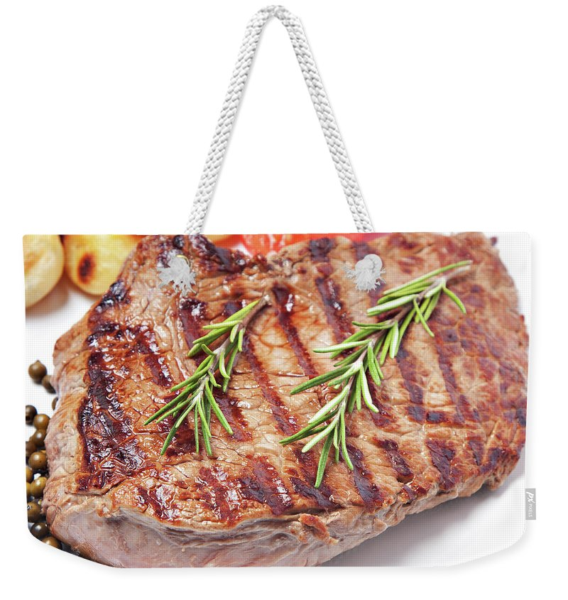 Tenderloin Weekender Tote Bag featuring the photograph Steak With Potatoes And Tomatoes by Svariophoto