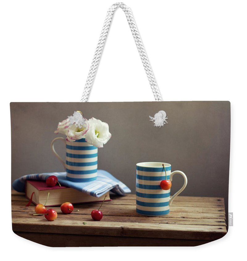 Cherry Weekender Tote Bag featuring the photograph Still Life With Striped Cups by Copyright Anna Nemoy(xaomena)
