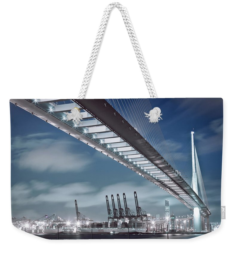 Built Structure Weekender Tote Bag featuring the photograph Stonecutters And Container Terminal by Andi Andreas